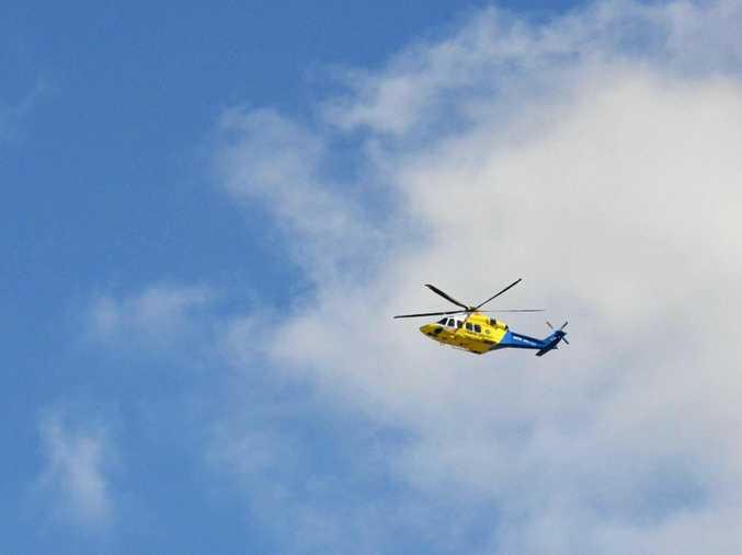 The RACQ LifeFlight helicopter leaves Kingaroy Hospital following a crash on the D'Aguliar Hwy.