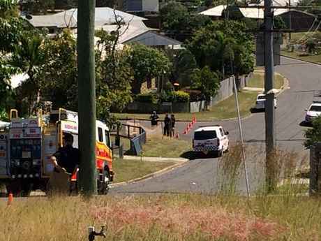 STAND OFF: Police are manning multiple road blocks at Oregon Court and Wattle St.