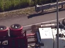 Truck rollover closes south-east Qld motorway