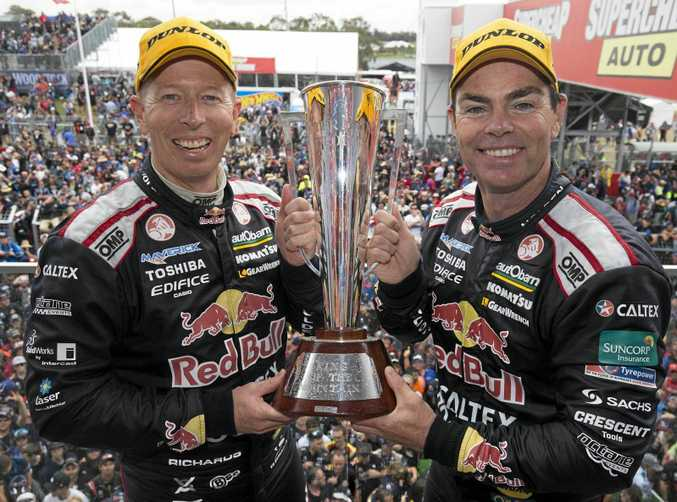 Holden drivers Craig Lowndes and Steven Richards celebrate victory in the 2015 Bathurst 1000 at Mount Panorama.