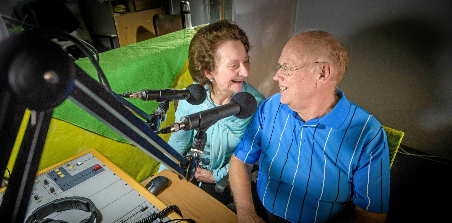 Carol and Paul Ordish at the microphone at Loving Life FM.
