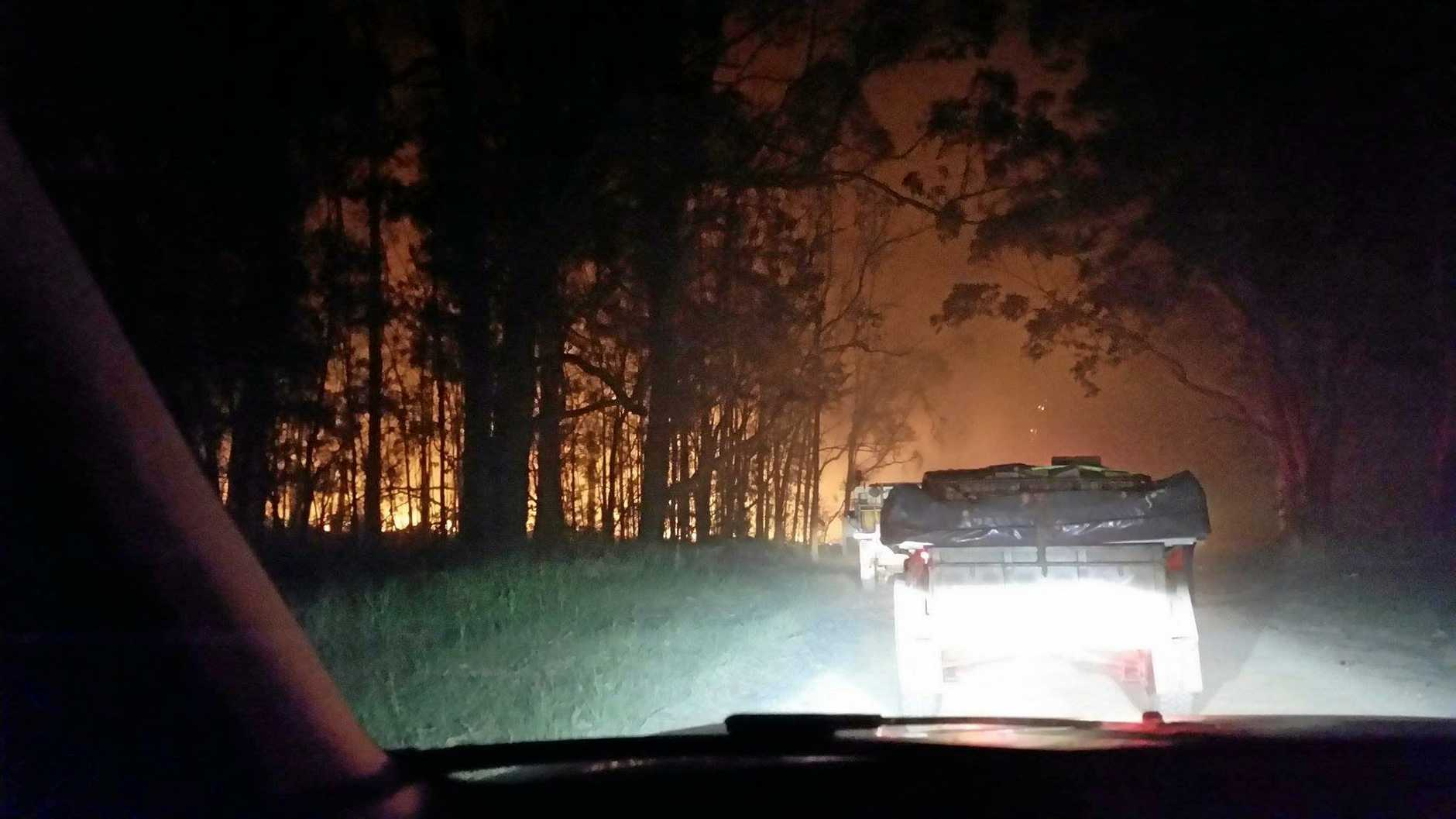 SMOKE AND FIRE: Holiday-maker Hannah Winter took this photo as she and her partner were being evacuated from the Pebbly Beach campground in the early hours of Saturday morning.