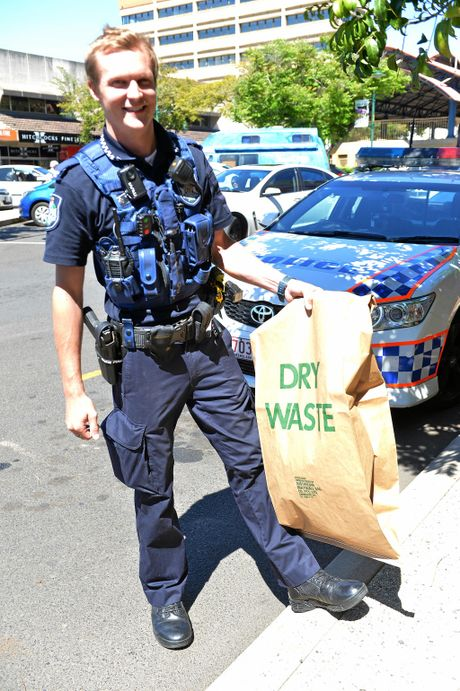 BAGGED: Constable Ethan Ramsey stepped up to catch a snake in the Bundaberg CBD.