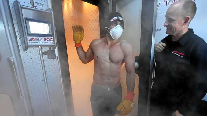 Wallaby Nick Phipps emerges from a cryogenics chamber following a training session at the Lensbury Hotel in London.
