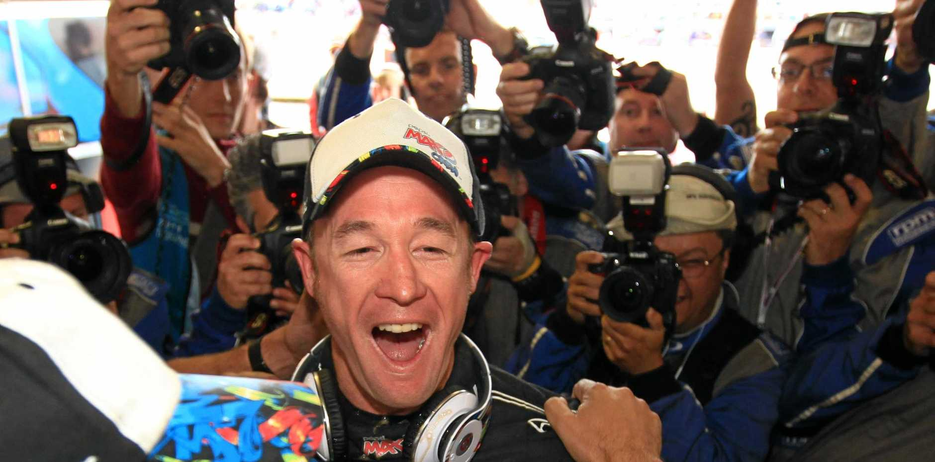 Kelly Racing's Greg Murphy reacts after claiming pole for the 2011 Bathurst 1000.