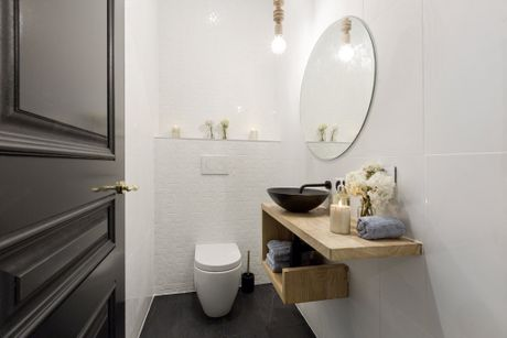 Will and Karlie's winning powder room with custom- made vanity.