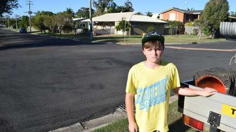 YOUNG HERO: Jayden Scott, 11, took care of a mother and two children after a crash that occured in the street behind him.