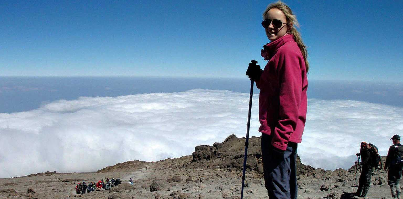 Alyssa Azar above the clouds on Mt Kilimanjaro.