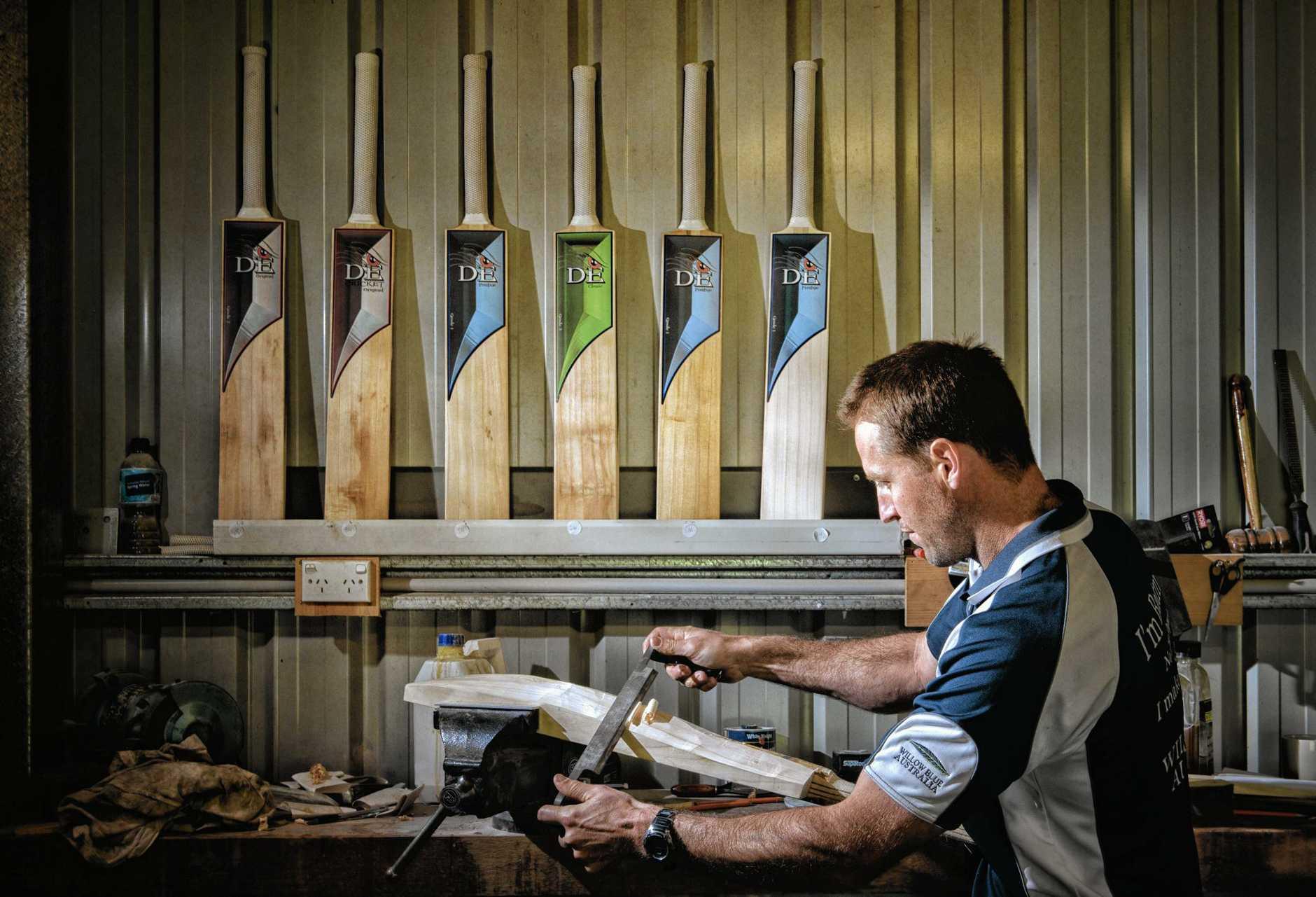 Adam Elliott at work hand shaping cricket bats.