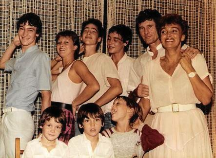 Sixteen-year-old Karen (back row, second from left) with her parents and six brothers.