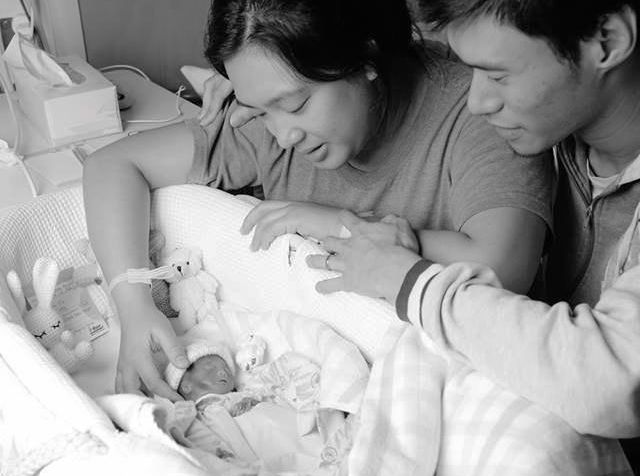 Amelia Grace Nguyen was born on Thursday September 22, just 22 weeks into the pregnancy. With her is mother Ellanah Nguyen and father Raymond Nguyen.