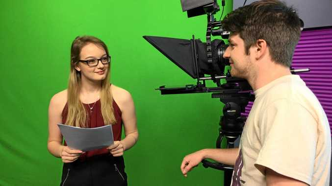 ACTION: QTV This Week host Natasha Morton, with Emerge music interviewer Calen Le Couteur.