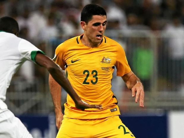 UNDER PRESSURE: Socceroo Tom Rogic tries to pick a way through Saudi Arabia's defence during their World Cup qualifier in Jeddah.