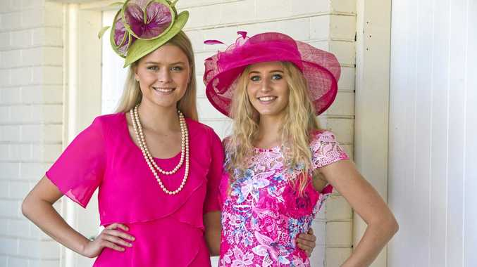 DRESS UP: Emma Florance (left) and Georgia Marsh model clothing from Bramptons Toowoomba, as they prepare for the fashion parade at the Rotary Club of Toowoomba City's Melbourne Cup Luncheon.