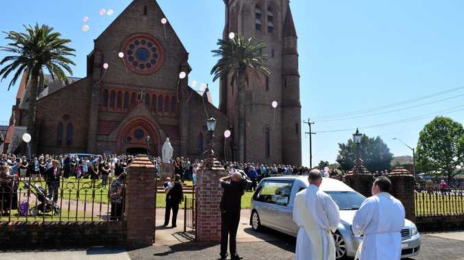 LIVE LIFE LARGE: Pink and white balloons are released at the funeral of Jodie McRae, at St Carthage's Cathedral.
