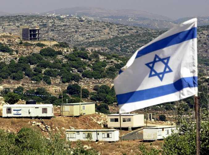 The Israeli flag flies over the Alonoi Shilo Jewish settlement.