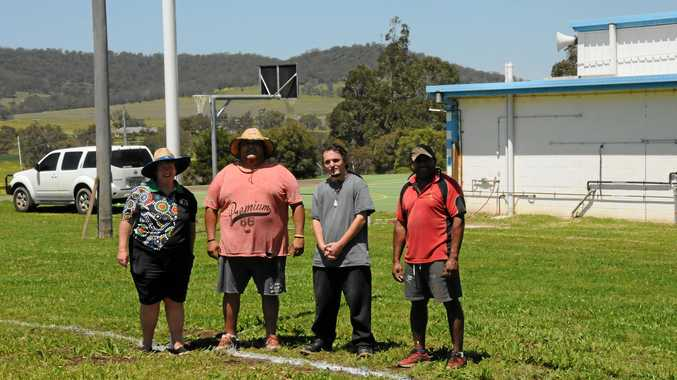 ON THE JOB: Jack Martin Complex volunteer workers (from left) Trish Cochrane, Arnold Anderson, Peter Daniels and Tom Clevin prepare facilities for today's indigenous rugby league carnival.