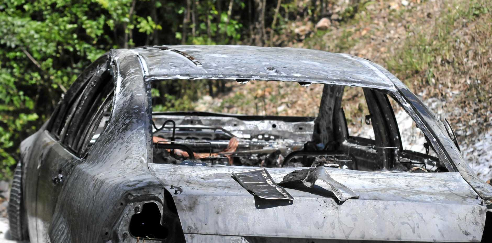 The burnt remains of a vehicle that was allegedly dumped at Six Mile.