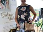 Amie Barclay showing off her prizes for Best Dressed Lady in the Rose City Shoppingworld Fashions on the Field.