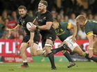 New Zealand captain Kieran Read runs with the ball as South Africa's Pieter-Steph du Toit tries to tackle him during their Rugby Championship Test match in Durban.