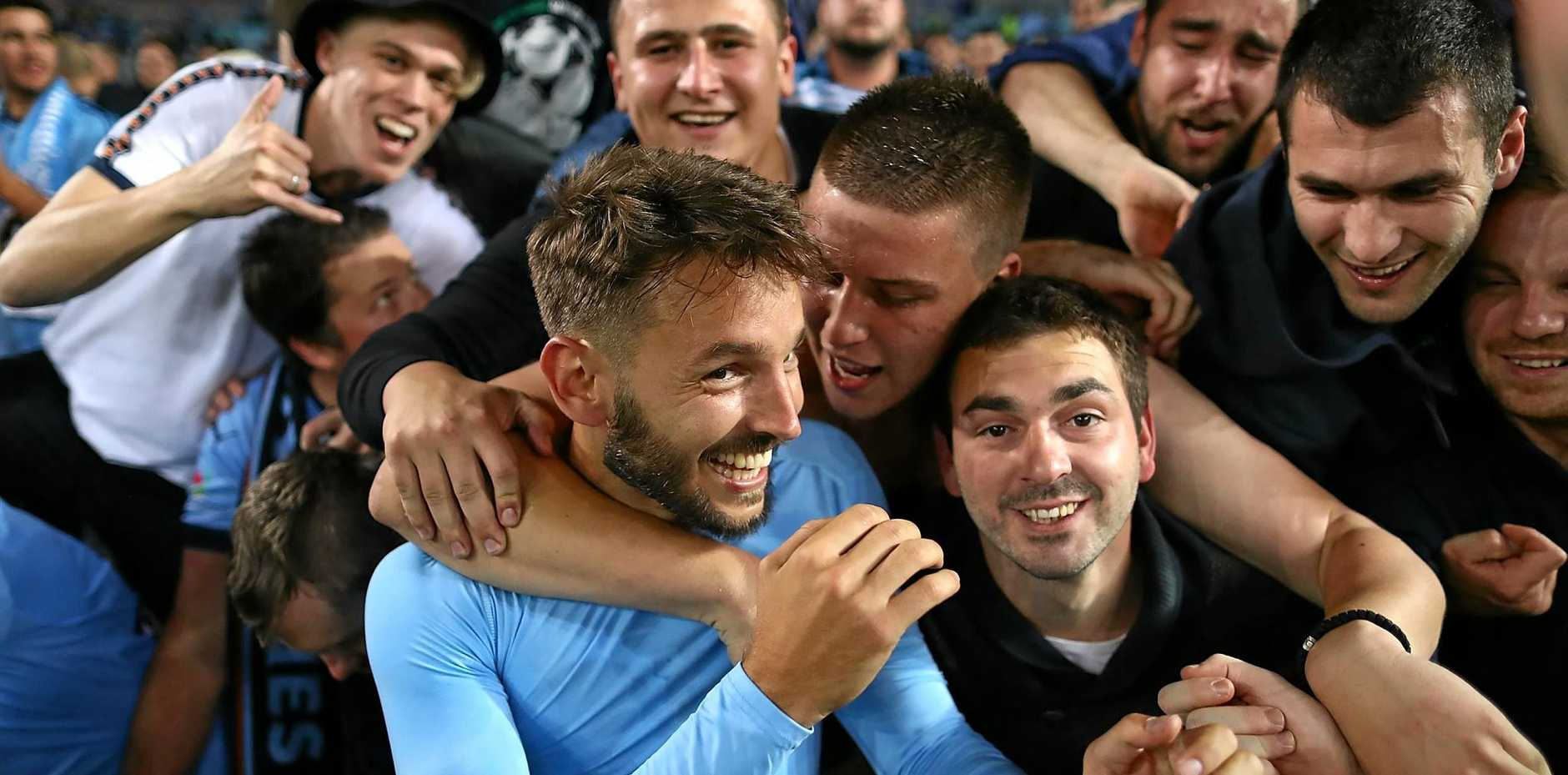 Milos Ninkovic of Sydney FC celebrates with fans after the round one A-League match against the Western Sydney Wanderers at ANZ Stadium.