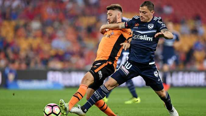 James Troisi of the Melbourne Victory (right) competes for the ball with Brandon Borrello of the Brisbane Roar during their round one A-League game at Suncorp Stadium.