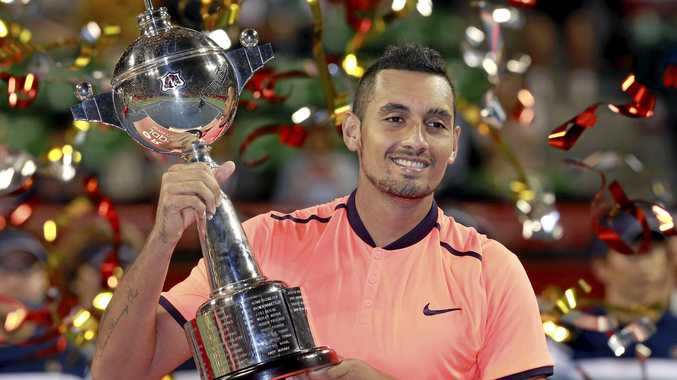 Nick Kyrgios of Australia poses after beating David Goffin of Belgium at the final match of Japan Open tennis tournament in Tokyo.
