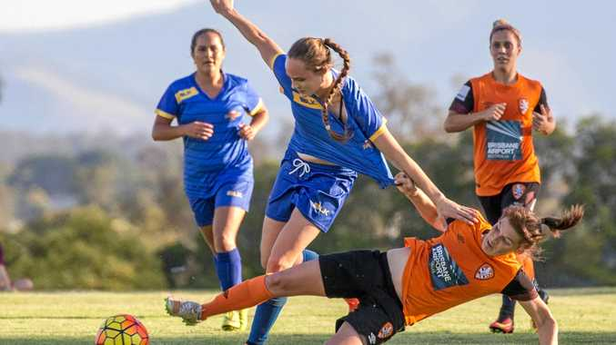 BIG TACKLE: Brooke Spencer of the Brisbane Roar brings down Abbey Lloyd of the South-West Queensland Thunder in Saturday's pre-season friendly.