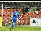 EARLY DAYS: Newcastle Jets keeper Pierce Clarke dives for the South-West Thunder in 2015.