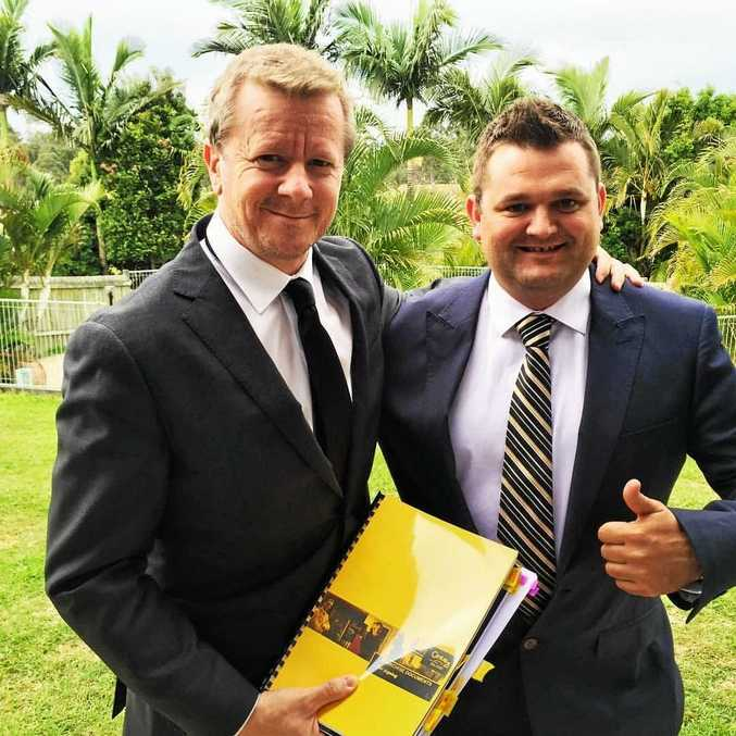 Billy Mitchell (right) with Queensland franchise manager at Century 21, Glenn Stanton, will be joining his staff and donning pink jackets and accessories for the month of October for the 'Pink Ribbon' campaign.