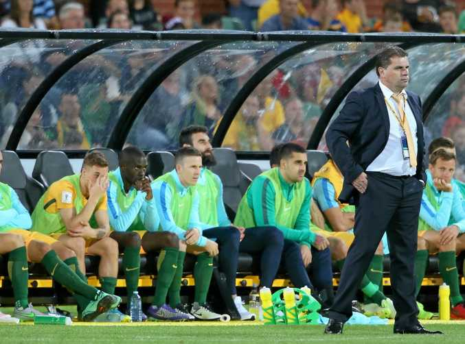 Australia's coach Ange Postecoglou (right) is playing it cool before the Socceroos' WOrld Cup qualifier against Japan.