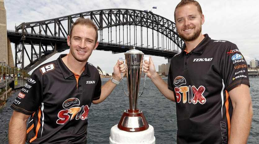 Will Davison (left) and Jonathon Webb with their Peter Brock Trophy for winning Sunday's Bathurst 1000.