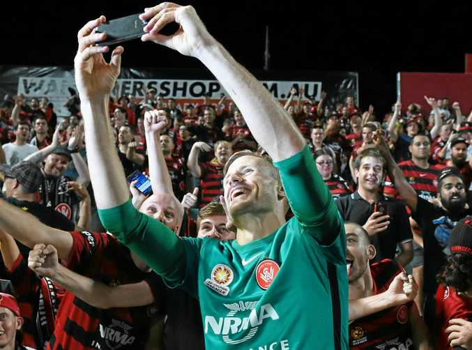 Andrew Redmayne of the Wanderers takes a selfie with fans.