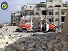 A destroyed ambulance is seen outside the Syrian Civil Defence main centre after air strikes in the Ansari neighbourhood of the rebel-held part of eastern Aleppo. Photo: SYRIAN CIVIL DEFENCE WHITE HELMETS/AP