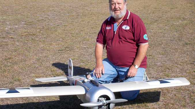 FLY-IN: Barry McDonald of Gympie with his model Eindecker, a German aircraft which made a big impact on the First World War.