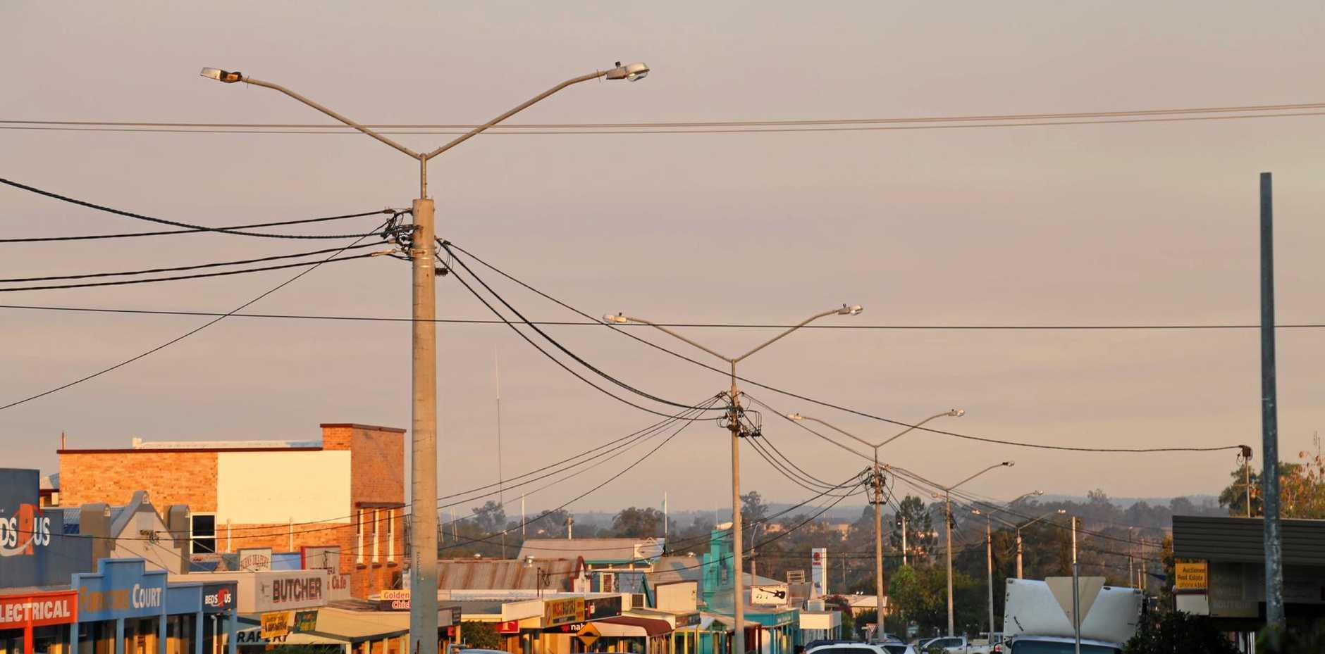 Smoke from the Bushfire at Derri Derra covering the main street of Mundubbera at sunset.