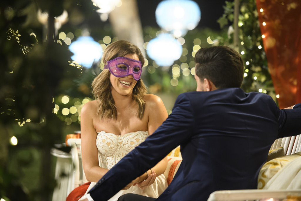Georgia Love pictured at a cocktail party in a scene from the TV series The Bachelorette.