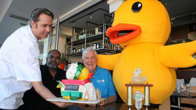 SERVING DUCK WELL-DRESSED: La Cucina di Vino chef, Mitchell Harland, serves up the restaurant's well-dressed duck to owner Danny Singh, president of the Rotary Club of Ballina John Anderssen and Lucky Duck.