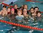 Young swimmers, including members of the Hockings family, join Ipswich Olympic swimmer Leah Neale in the pool at the latest Swimathon.