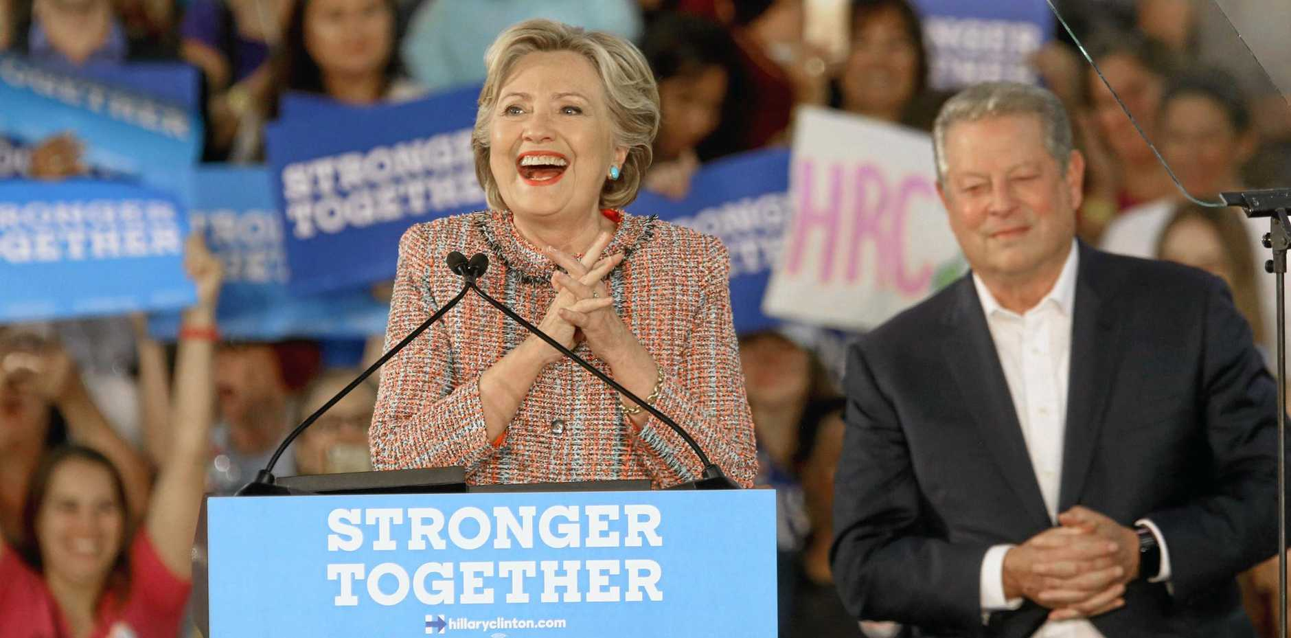 Democratic presidential candidate Hillary Clinton is joined at a Miami rally by former vice-president Al Gore.