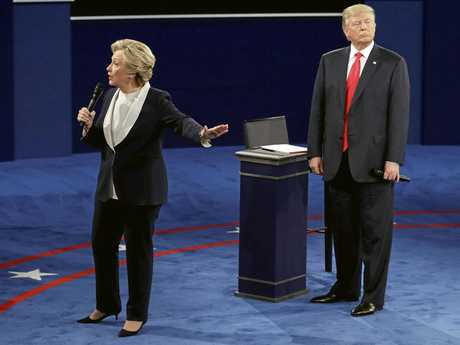 Republican presidential nominee Donald Trump listens to Democratic presidential nominee Hillary Clinton during the second presidential debate at Washington University, Sunday, Oct. 9, 2016, in St. Louis. (AP Photo/John Locher)