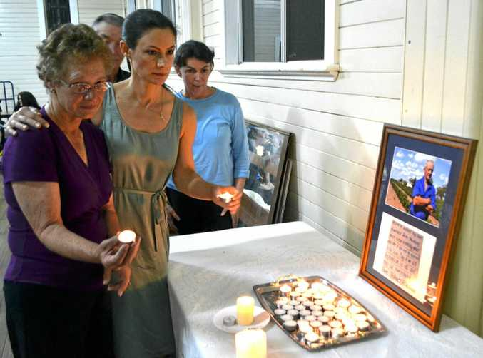 NOT FORGOTTEN: George Bender's wife Pam and daughter Helen light candles at his memorial service in 2015.