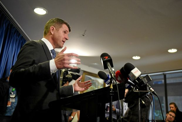 ABOVE: NSW Premier Mike Baird announces his backflip on the greyhound ban in Sydney on Tuesday.