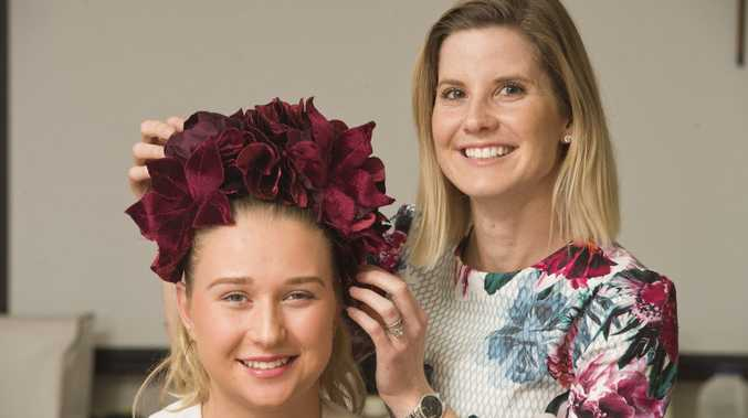 FLORAL FUN: Fairholme College student Katie Wagner (left) models a flower crown designed by milliner Katie Davidson as part of Fairholme Fashion Week.