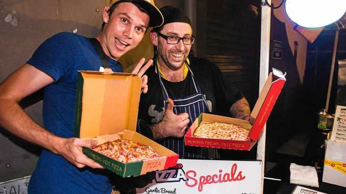 Luke Soanes (left) and owner Craig Mawhinney enjoying a pizza from Mr Mawhinney's newest venture.