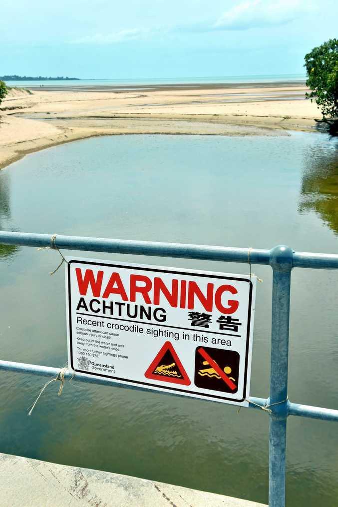 Signs appeared along Tooan Tooan Creek, Pialba, warning of a recent crocodile sighting.