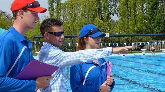 SAVING LIVES: Lifeguard Reece Rowbottom (left) with Gary Johnson and lifeguard Hayley Gollan.