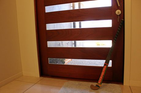 The anxiety in this household was so great they kept a hockey stick permanently next to the door.
