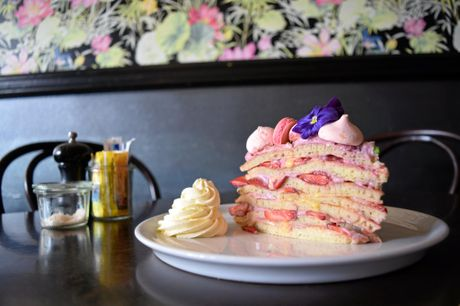 PRETTY AS A PICTURE: The pancake cake from Bundaberg cafe Indulge featuring strawberries, lemon curd, meringue, a green crumb, edible flowers and mulberry cream.