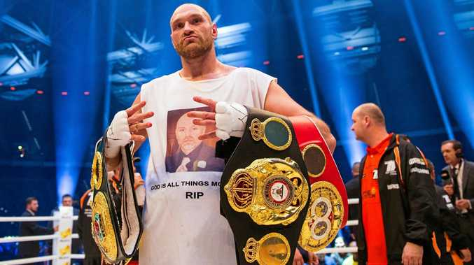 British boxer Tyson Fury celebrates in the ring after his victory over Ukraine's Vladimir Klitschko in their world heavyweight title bout in Duesseldorf, Germany, in November.